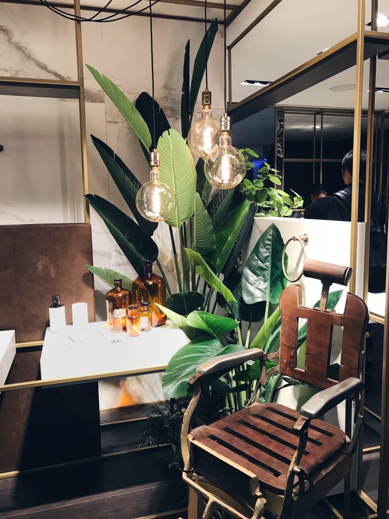 Gessi bathroom style with tropical plants