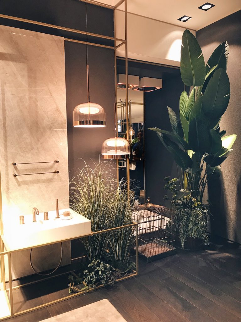 Gessi bathroom collection with tropical plants and Fontana Arte lamps